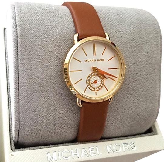 Preload https://img-static.tradesy.com/item/25592481/michael-kors-browngold-new-women-s-gold-tone-and-luggage-leather-portia-mk2734-watch-0-1-540-540.jpg