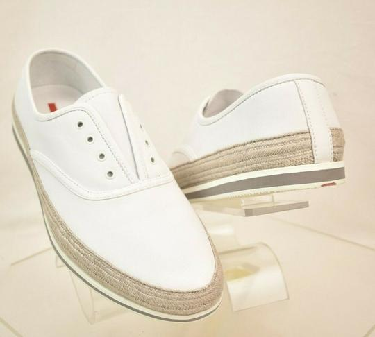 Preload https://img-static.tradesy.com/item/25592592/prada-white-aviator-leather-contrast-platform-slip-on-laceless-sneakers-10-us-11-shoes-0-0-540-540.jpg