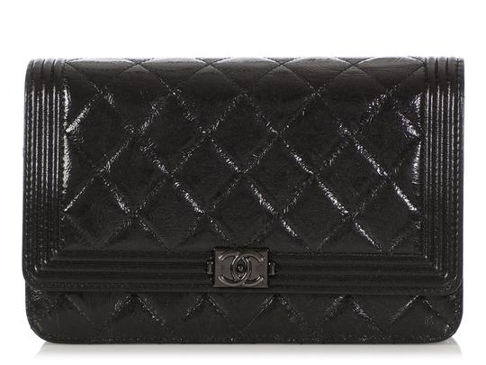 Preload https://img-static.tradesy.com/item/25596165/chanel-wallet-on-chain-boy-woc-quilted-distressed-so-black-patent-leather-cross-body-bag-0-0-540-540.jpg