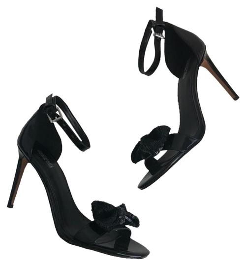 Preload https://img-static.tradesy.com/item/25599873/michael-kors-black-sandals-size-us-7-regular-m-b-0-1-540-540.jpg
