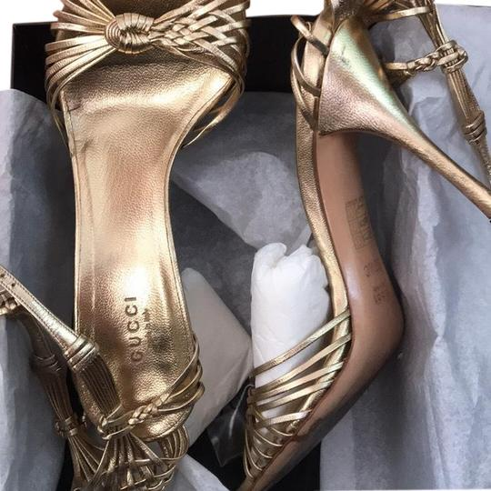 Preload https://img-static.tradesy.com/item/25600147/gucci-gold-strappy-sandals-pumps-size-us-9-regular-m-b-0-1-540-540.jpg