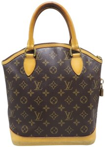 Louis Vuitton Lv Monogram Vertical Lockit Pm Tote in Brown