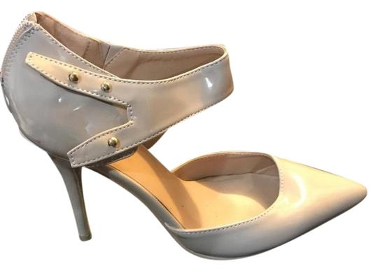 Preload https://img-static.tradesy.com/item/25600812/forever-21-nude-patent-leather-pointed-pumps-size-us-85-regular-m-b-0-1-540-540.jpg