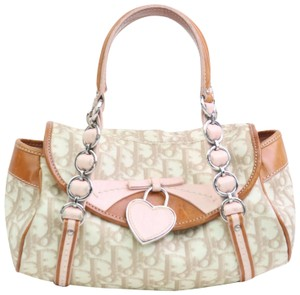 Dior Mint Condition Canvas/Leather Romantique Flap Accents Satchel in beige trotter style logo print canvas and pink and brown leather with a chrome and pink leather 'Dior' heart charm