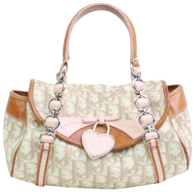 Dior 'romantique' Beige Trotter Style Logo Print Canvas and Pink and Brown Leather with A Chrome and Pink Leather 'dior' Heart Charm Coated Satchel Dior 'romantique' Beige Trotter Style Logo Print Canvas and Pink and Brown Leather with A Chrome and Pink Leather 'dior' Heart Charm Coated Satchel Image 1