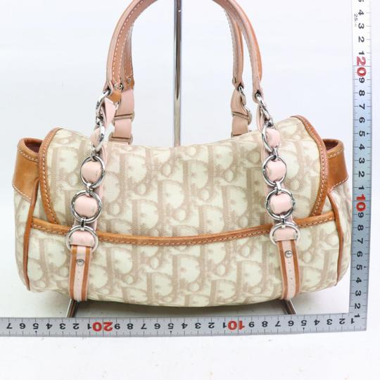 Dior Mint Condition Canvas/Leather Romantique Flap Accents Satchel in beige trotter style logo print canvas and pink and brown leather with a chrome and pink leather 'Dior' heart charm Image 6
