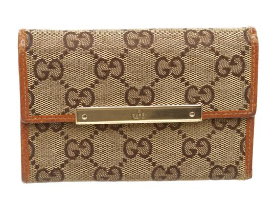 Preload https://img-static.tradesy.com/item/25607155/gucci-brown-beige-gg-canvas-leather-wallet-0-0-540-540.jpg