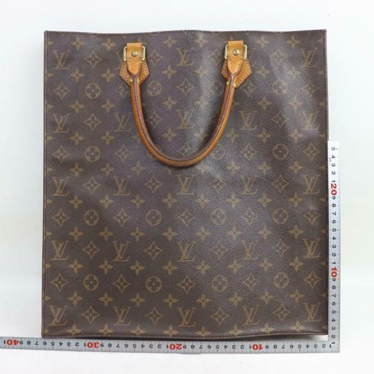 Louis Vuitton Canvas Leather Monogram Tote in Brown Image 1