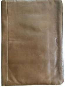 Cole Haan leather portfolio, soft leather , large can fit 13 in laptop or iPad and with sleeves for folders and pockets for accessories. Elegant and classic look.