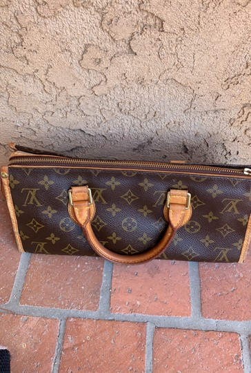Louis Vuitton Satchel in brown. Image 1