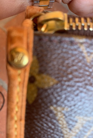 Louis Vuitton Satchel in brown. Image 10