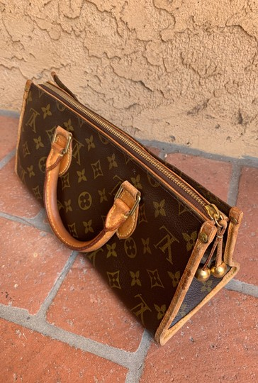 Louis Vuitton Satchel in brown. Image 11