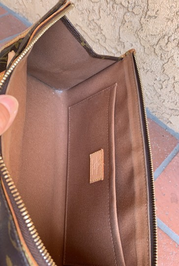 Louis Vuitton Satchel in brown. Image 6