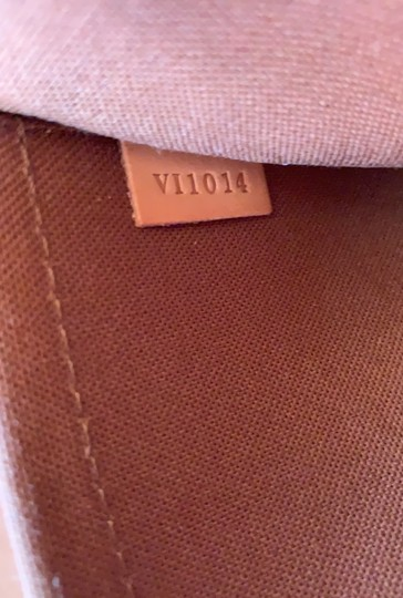 Louis Vuitton Satchel in brown. Image 8