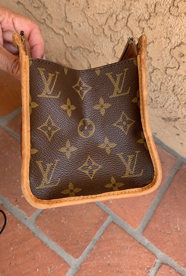 Louis Vuitton Satchel in brown. Image 9