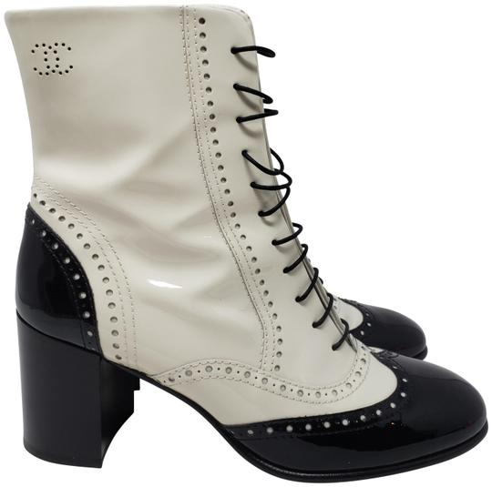 Preload https://img-static.tradesy.com/item/25615958/chanel-black-white-patent-leather-cc-logo-round-toe-ankle-bootsbooties-size-eu-385-approx-us-85-regu-0-3-540-540.jpg