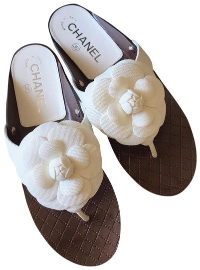 Preload https://img-static.tradesy.com/item/25618771/chanel-white-grosgrain-camellia-flower-flip-flop-sandals-mulesslides-size-eu-38-approx-us-8-regular-0-2-540-540.jpg
