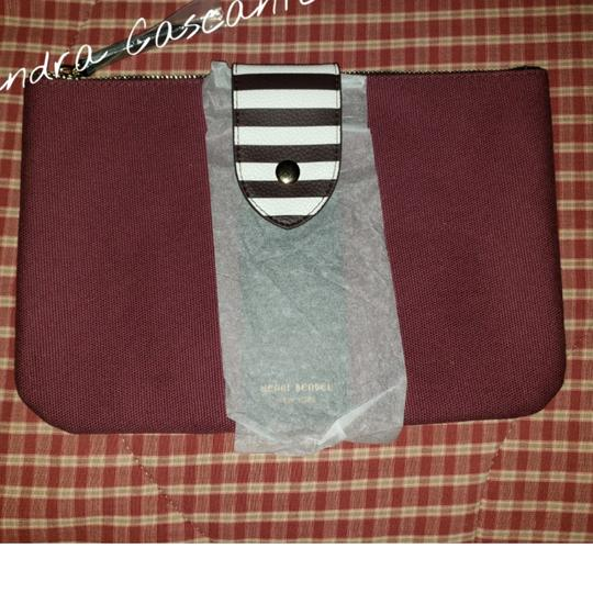 Preload https://item3.tradesy.com/images/henri-bendel-gwp-pouch-burgundy-canvas-clutch-25619067-0-1.jpg?width=440&height=440