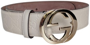 Gucci Gucci Logo Embossed Leather Belt