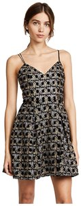 Alice + Olivia short dress Black, Gold, Silver on Tradesy