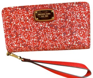 Michael Kors Wristlet in red with flowers