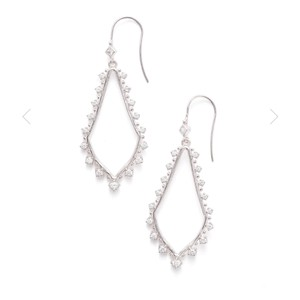 "Kendra Scott Your favorite everyday accessory receives a sparkling update with the Bea drop earrings in silver, featuring a subtle sloping silhouette and studded crystals surrounding a delicate silver frame. These drop earrings are a go-to for any night out or day at the office. * Rhodium tone-plated Brass, cubic zirconia * 2""L * French wire * Brand new on Kendra Scott earring card * Kendra Scott dust bag included"