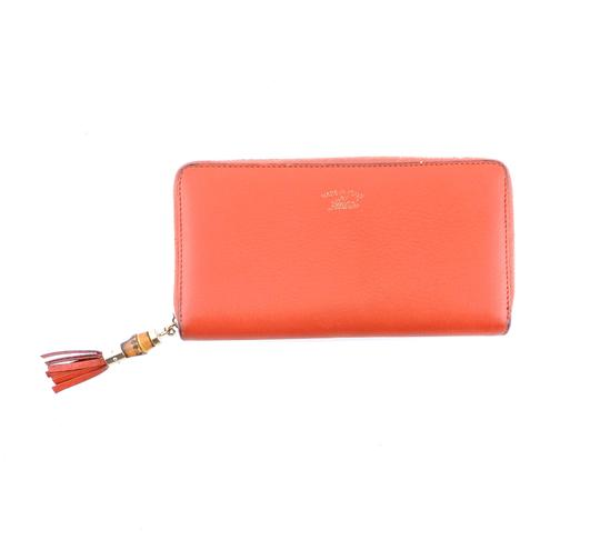 Preload https://img-static.tradesy.com/item/25638126/gucci-coral-zippy-clutch-pebbled-soft-leather-wallet-0-1-540-540.jpg