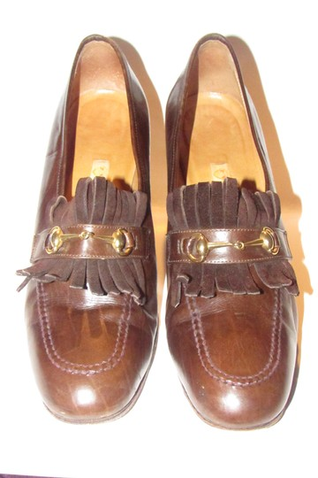 Preload https://img-static.tradesy.com/item/25638318/gucci-brown-leather-with-tassels-and-equestrian-design-marrakech-vintage-loafer-style-accents-pumps-0-0-540-540.jpg