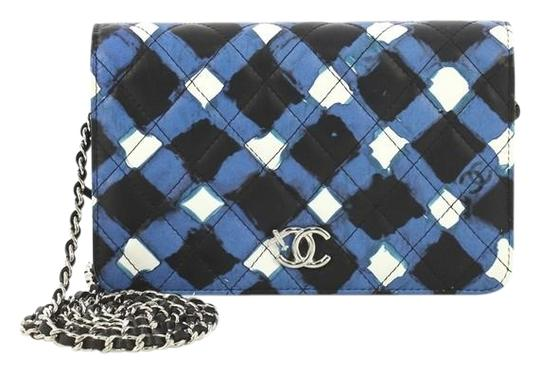Preload https://img-static.tradesy.com/item/25638780/chanel-wallet-on-chain-airlines-quilted-printed-white-black-and-blue-leather-clutch-0-1-540-540.jpg