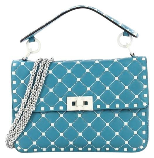 Preload https://img-static.tradesy.com/item/25638845/valentino-flap-free-rockstud-spike-quilted-medium-blue-leather-shoulder-bag-0-1-540-540.jpg