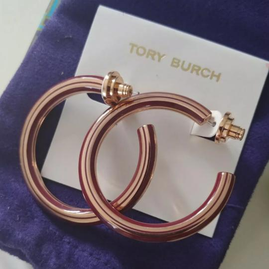 Preload https://item3.tradesy.com/images/tory-burch-tuscan-wine-rose-gold-t-stretched-logo-hoop-earrings-25649672-0-1.jpg?width=440&height=440