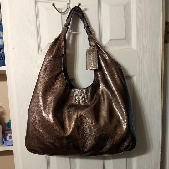 Preload https://item4.tradesy.com/images/coach-silver-patent-leather-hobo-bag-25650068-0-3.jpg?width=440&height=440