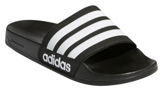 Preload https://img-static.tradesy.com/item/25650101/adidas-blackwhite-swim-slide-sandals-size-us-11-regular-m-b-0-1-540-540.jpg