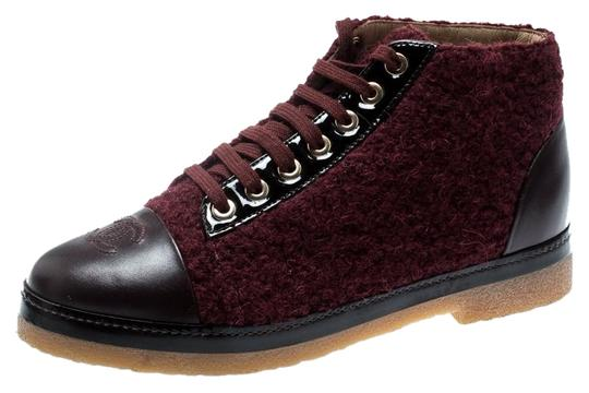 Preload https://img-static.tradesy.com/item/25651616/chanel-burgundy-tweed-and-leather-cc-cap-toe-high-top-sneakers-bootsbooties-size-eu-37-approx-us-7-r-0-1-540-540.jpg