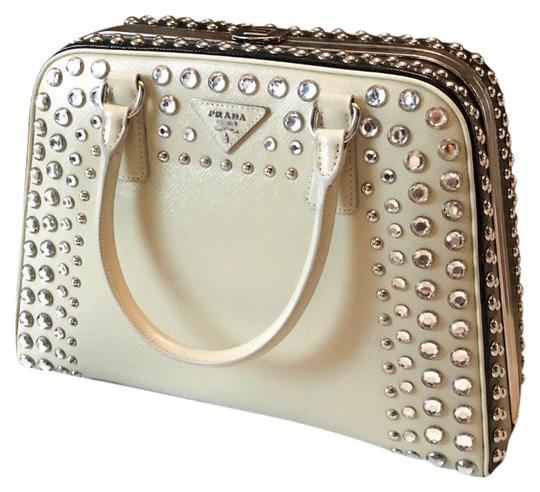 Preload https://img-static.tradesy.com/item/25654757/prada-pyramid-lux-saffiano-crystal-studded-embellished-cream-black-satchel-0-2-540-540.jpg