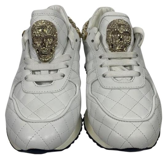 Preload https://img-static.tradesy.com/item/25657603/philipp-plein-white-and-gold-quilted-studded-skull-sneakers-size-eu-36-approx-us-6-regular-m-b-0-1-540-540.jpg