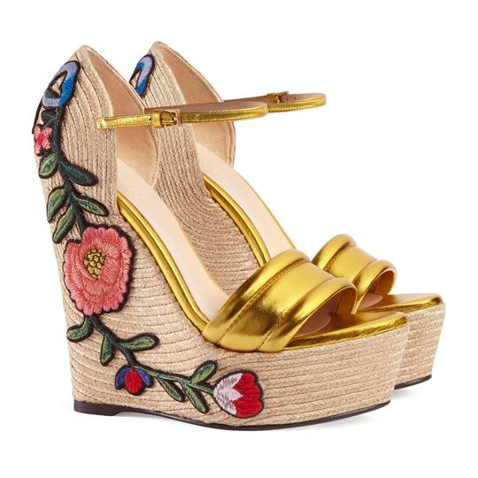Preload https://img-static.tradesy.com/item/25657942/gucci-gold-women-s-leather-floral-embroidered-espadrille-wedges-size-us-95-regular-m-b-0-0-540-540.jpg