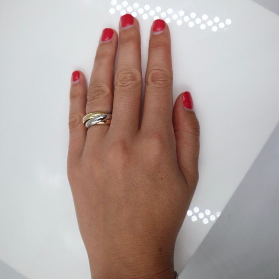 cartier trinity ring on hand