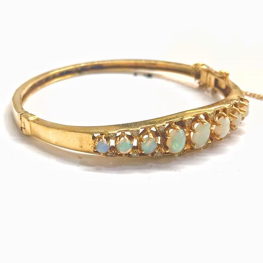 DeWitt's VINTAGE!! 14 Karat Yellow Gold Opal and Diamond Bangle Bracelet Image 1
