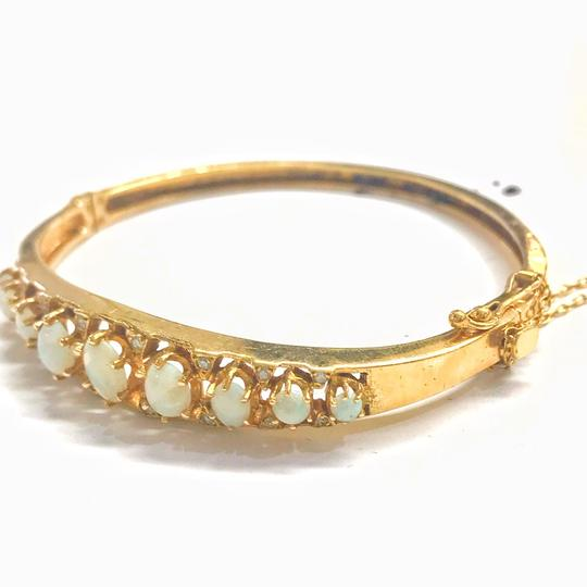 DeWitt's VINTAGE!! 14 Karat Yellow Gold Opal and Diamond Bangle Bracelet Image 2