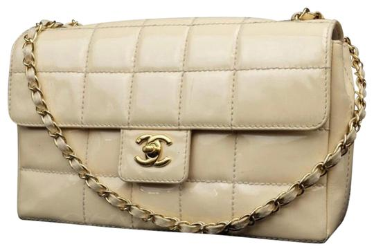 Preload https://img-static.tradesy.com/item/25667200/chanel-chocolate-bar-220855-light-beigeivory-flap-beigeivory-patent-leather-shoulder-bag-0-1-540-540.jpg
