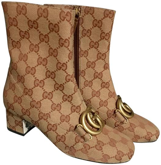 Preload https://img-static.tradesy.com/item/25667386/gucci-brown-victoire-monogram-canvas-gold-double-gg-logo-ankle-heel-bootsbooties-size-eu-35-approx-u-0-5-540-540.jpg