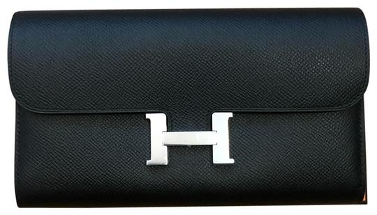 Preload https://img-static.tradesy.com/item/25671146/hermes-black-long-constance-wallet-0-1-540-540.jpg