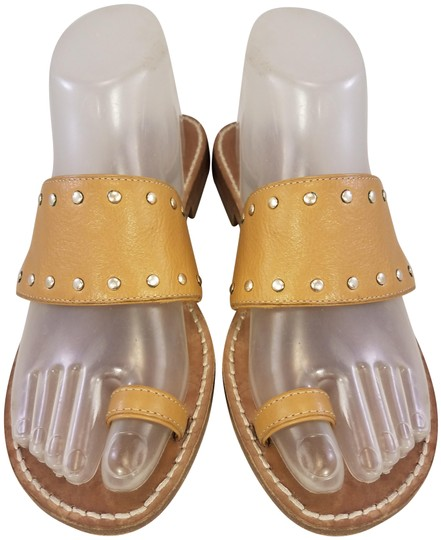 Preload https://img-static.tradesy.com/item/25671171/michael-kors-beige-studded-tan-leather-toe-loop-slides-m-sandals-size-us-75-regular-m-b-0-1-540-540.jpg