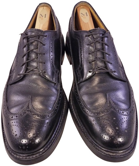 Preload https://img-static.tradesy.com/item/25671289/florsheim-black-vintage-man-oxfords-pebbled-leather-wingtip-formal-shoes-size-us-105-regular-m-b-0-1-540-540.jpg