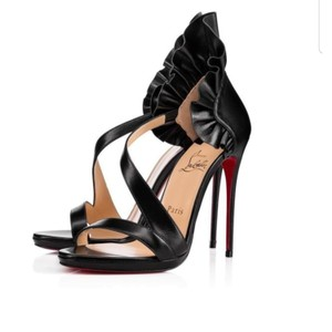Christian Louboutin Authentic CHRISTIAN LOUBOUTIN Shiny Nappa Colankle Ruffle 120 Pumps 39 Black. These are asymmetric cross strap sandals in black leather. They are exquisitely detailed with an 4.5 inch heel that has a ruffled collar for the ankle. These are excellent pumps, with the iconic look only from Christian Louboutin! Pumps