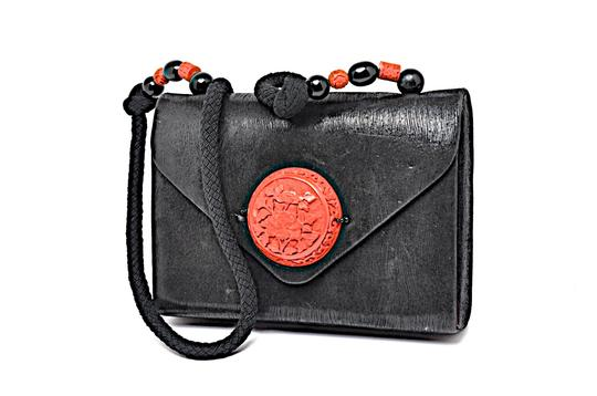 Preload https://img-static.tradesy.com/item/25679286/etched-carved-ornament-black-red-suede-leather-shoulder-bag-0-0-540-540.jpg