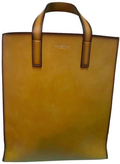 Preload https://img-static.tradesy.com/item/25679567/michael-kors-collection-luggage-leather-tote-0-1-540-540.jpg