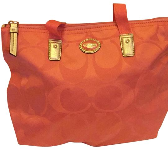 Preload https://img-static.tradesy.com/item/25679913/coach-coral-with-gold-satin-weekendtravel-bag-0-1-540-540.jpg