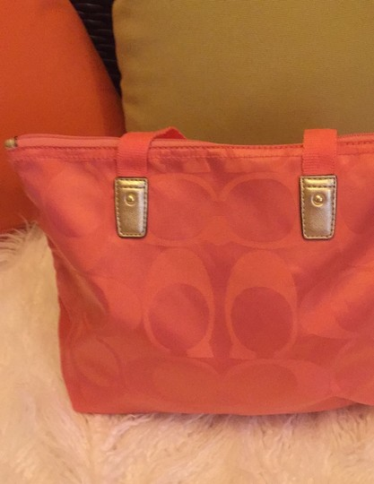 Coach coral with gold Travel Bag Image 3